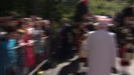 Exterior shots of Queen Elizabeth inspecting the pipe band of the Argyll and Sutherland Highlanders with Major Jason French>> on August 07 2014 in...