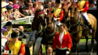 Exterior shots of Queen finishing speech at podium before being saluted by fanfare and walking into Royal Ascot main building on June 03 2014 in...