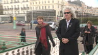 Exterior shots of Queen singer Brian May walking onto a bandstand with the Green Party's Caroline Lucas on April 13 2015 in Brighton England