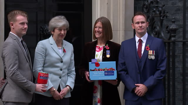 Exterior shots of representatives from the Royal British Legion's Poppy Appeal arriving at Number 10 Downing Street and Theresa May posing for photo...