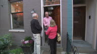 Exterior shots of republican canvassers going door to door in Cincinnati talking to householders during the 2012 US Presidential Election campaign on...