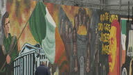 Exterior shots of Republican murals on the 'International Wall' at the top of Falls Road in west Belfast and tourists taking photographs>> on July 25...