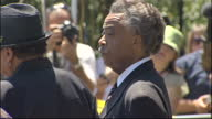 Exterior shots of Reverend Al Sharpton Joe Jackson and Marshall Thompson walking and talking to the press prior to the Michael Jackson memorial...