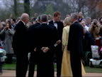 Exterior shots of Royal family arriving for evening reception with crowds waving Union Jack flags and singing God Save the Queen Royals include...