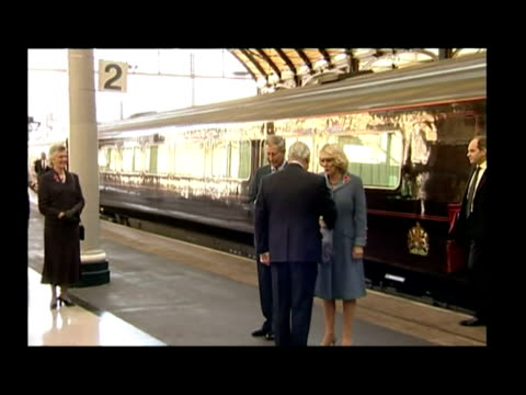 Exterior shots of royal train pulling into Newcastle Central Station and Prince Charles Camilla alighting Interior shots of Charles and Camilla...
