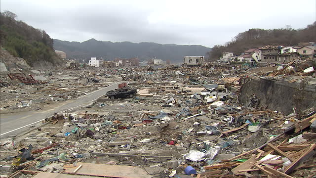 Exterior shots of rubble from completely destroyed buildings and cars after an earthquake tsunami hit the area Filmed on March 22 2011 in Onagawa...