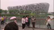 Exterior shots of security guards and tourists at the Bird's Nest National stadium on July 30 2009 in Beijing China