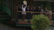 Exterior shots of Serena Williams holding up Women's Wimbledon winner's trophy waving to crowds from balcony Serena Williams Shows Trophy to...
