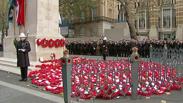 Exterior shots of service men and women stood for two minute's silence at 11am at the Cenotaph on Armistice Day on November 11 2014 in London England