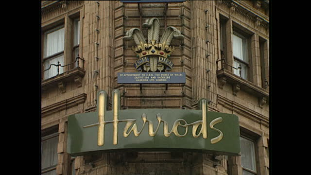 Exterior shots of shoppers at Harrods a Harrods Green Man on duty a Harrods branded horse carriage and exterior wide shots of the Harrods building on...
