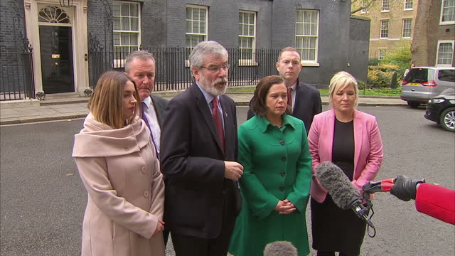 Exterior shots of Sinn Fein president Gerry Adams speaking to members of the media about the meeting he and other members of the Sinn Fein delegation...