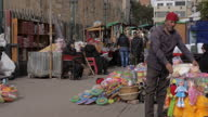 Exterior shots of souk street market people shopping vendors by stalls on January 15 2015 in Cairo Egypt