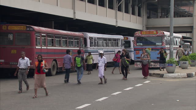 Exterior shots of street scenes and buses at Galle bus station passengers waiting in lobby on September 2 2014 in Galle Sri Lanka