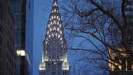 Exterior shots of street scenes in Manhattan as evening falls including the Chrysler Building lit up against the skyline on April 29 2017 in New York...