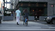 Exterior shots of street scenes in Manhattan including pedestrians walking along and crossing the road near East 42nd Street on April 29 2017 in New...