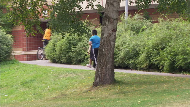 Exterior shots of streetscenes Syrian immigrants and children playing together outside of a housing estate on August 27 2015 in Sodertalje Sweden