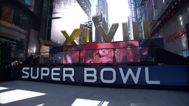 Exterior shots of Superbowl fans gathered in Times Square prior to the game including a large 'Super Bowl' sign and large screens on February 02 2014...