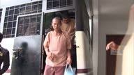 Exterior shots of suspects in the murder trial of British backpackers Hannah Witheridge and David Miller being led from a van into courtroom on July...