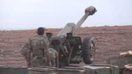 Exterior shots of Syrian Army soldiers firing D30 Howitzers in Latakia on December 21 2015 in Latakia Syria
