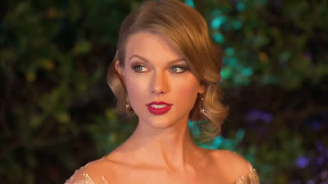 Exterior shots of Taylor Swift speaking to media and posing for photographs on the blue carpet arriving at the Winter Whites gala at Kensington...