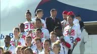 Exterior shots of Team GB athletes on the steps of a British Airways Boeing 747 and on the ground posing for a group photo with their medals on...