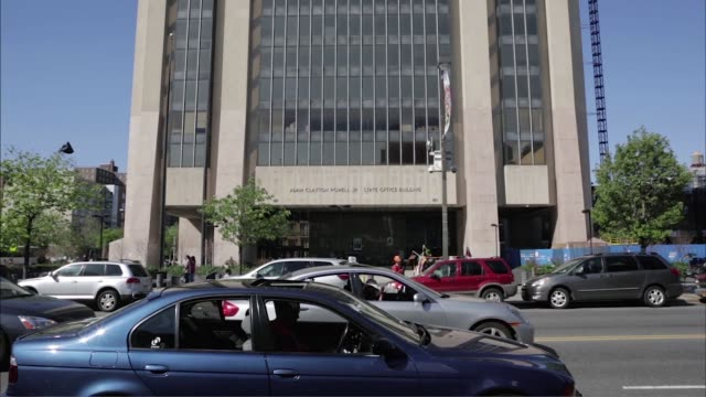 Exterior shots of the Adam Clayton Powell Jr State Office Building in Harlem New York Close up shots of the statue of Adam Clayton Powell Jr Infront...