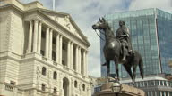 Exterior shots of the Bank of England including shots of the Threadneedle Street sign and equestrian statue of the Duke of Wellington on Bank junction