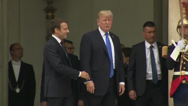 Exterior shots of The Beast Donald Trump's presidential limousine arriving at the Elysee Palace as Donald Trump emerges and poses for photos with...
