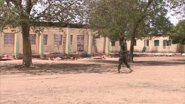 Exterior shots of the burnt out school in Chibok at which nearly 300 girls were kidnapped by Boko Haram with the charred remains of the classroom and...