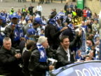 exterior shots of the Chelsea team celebrating winning the League Cup double with a victory parade in an open top bus