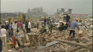 Exterior shots of the Chinese military clearing rubble from an earthquake struck village and pulling bodies of victims from rubble on May 16 2008 in...