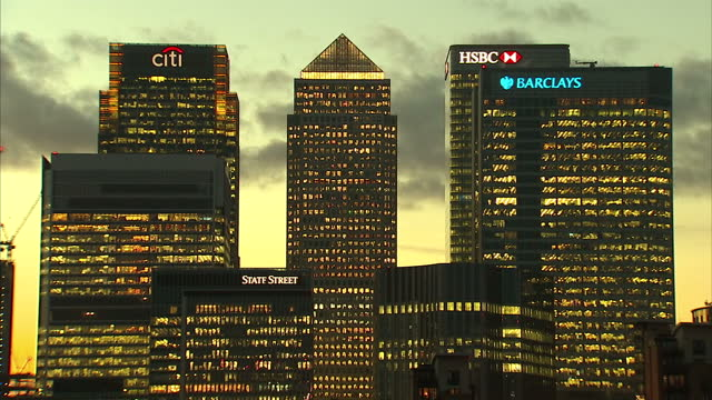 Exterior shots of the City of London at sunrise highlighting One Canada Square Barclays and HSBC buildings with the Thames in the foreground on 9...