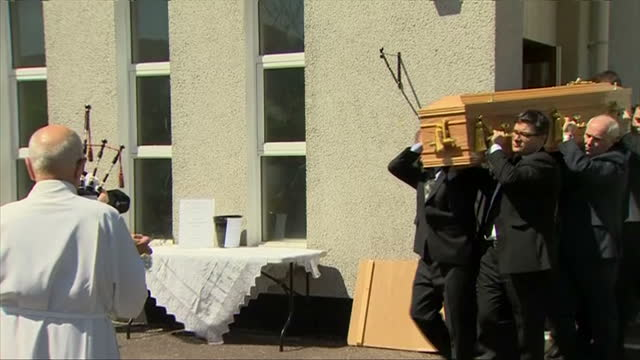 Exterior shots of the coffin of former Liberal Democrat Leader Charles Kennedy being carried and placed in a waiting hearse>> on June 12 2015 in Fort...