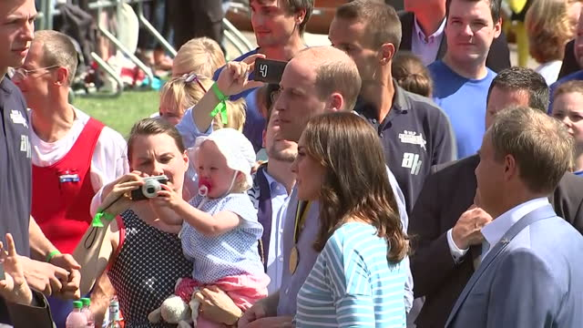 Exterior shots of the Duke and Duchess of Cambridge greeting members of the public after taking part in a boat race on the River Neckar on July 20...