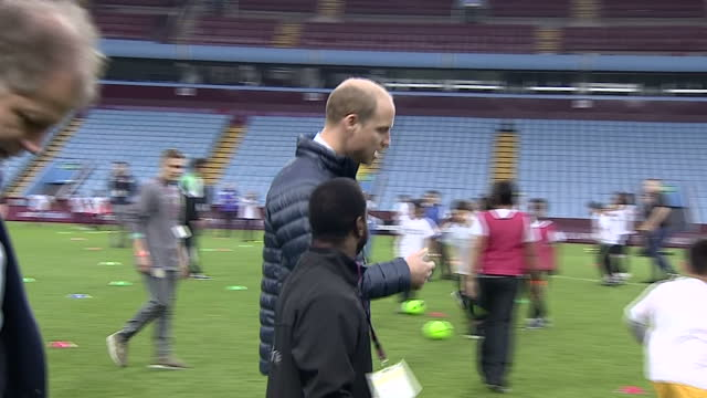 Exterior shots of the Duke and Duchess of Cambridge meeting coaches involved in the Coach Core programme on the pitch at Aston Villa Football Club on...