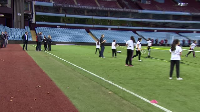Exterior shots of the Duke and Duchess of Cambridge meeting coaches involved in the Coach Core programme on the pitch at Aston Villa Football Club...
