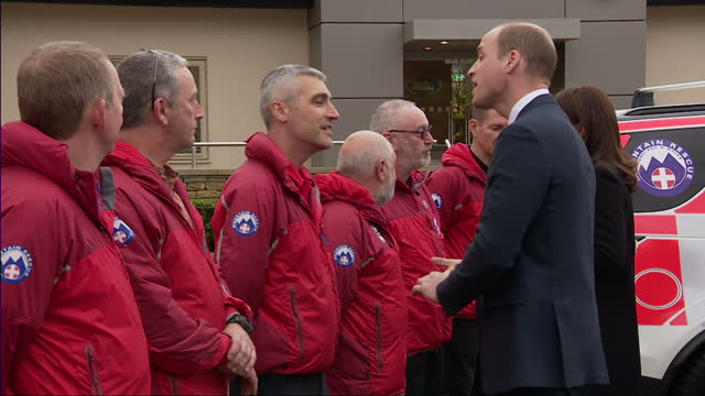 Exterior shots of the Duke and Duchess of Cambridge meeting search and rescue personnel during a visit to the Jaguar Land Rover experience centre on...