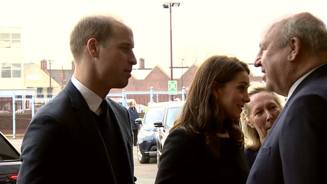 Exterior shots of the Duke and Duchess of Cambridge speaking to officials including Aston Villa owner Tony Xia and CEO Keith Wyness during a visit to...