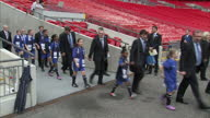 Exterior shots of the FIFA delegation team walking onto the Wembley pitch lead by mascots as part of their inspection of England's 2018 football...