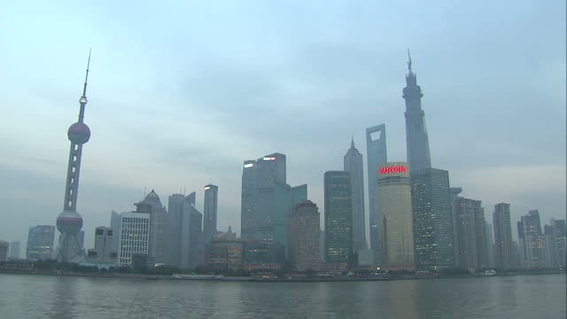 Exterior shots of the financial district of Pudong skyscrapers the Huangpu River seen from The Bund waterfront David Cameron in China on Trade...