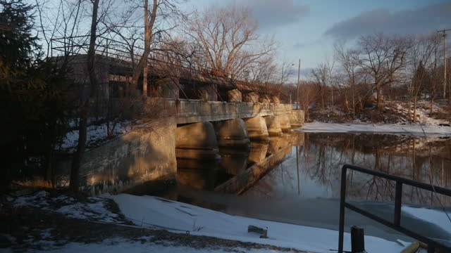 Exterior shots of the Flint River and a bridge over it during the Flint pollution crisis on January 22 2016 in Flint Michigan