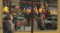 Exterior shots of the Harrods store in Knightsbridge showing festive window displays and shoppers carrying green Harrods bags Christmas shoppers and...