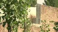 Exterior shots of the hideout villa and surrounding grounds of AlQaeda leader Osama Bin Laden in Abbottabad with Pakistani police guards patrolling...
