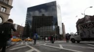Exterior shots of the IBM Watson Groups new headquarters at 51 Astor Place in New York NY Shots of commuters and pedestrians in New York walking...