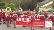 Exterior shots of the marching band of the Seattle Seahawks American Football team marching in a fourth of July carnival procession on 5 July 2017 in...