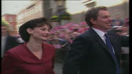 Exterior shots of the new Prime Minister Tony Blair and his wife Cherie Blair walk into Downing Street as Union Jackwaving crowds cheer after winning...