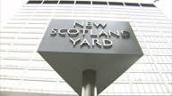 Exterior shots of the 'New Scotland Yard' sign outside the Metropolitan Police headquarters in Westminster New Scotland Yard Sign at Metropolitan...