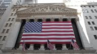 Exterior shots of the New York Stock Exchange on Wall Street in downtown Manhattan New York shot on July 2nd 2015 Shots A giant American flag covers...