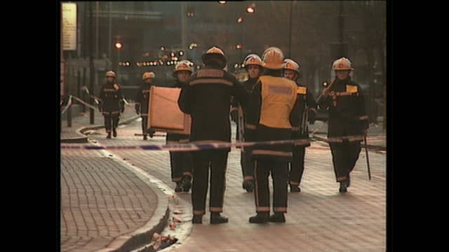 Exterior shots of the police cordon around the area of an IRA bomb explosion police investigators at the scene in the Docklands area on February 10...