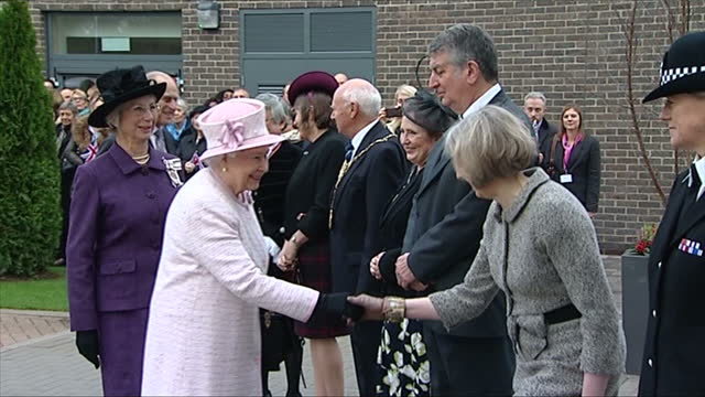 Exterior shots of the Queen and Duke of Edinburgh arriving at Holyport College and greeting officials including the Home Secretary Theresa May>> on...
